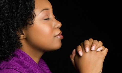 """Black woman praying"""